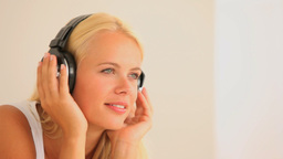Joyful woman listening to music Stock Video Footage