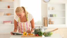 Housewife arranging vegetables Footage