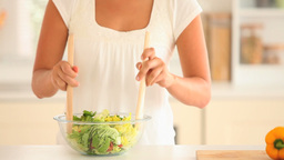 Woman preparing a salad Stock Video Footage