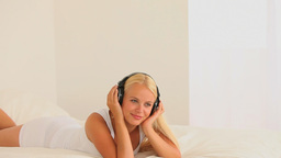 Woman enjoying listening to music Footage