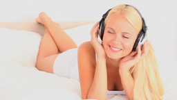 Cheery lady listening to music Stock Video Footage