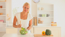 Woman preparing a salad for dinner Footage