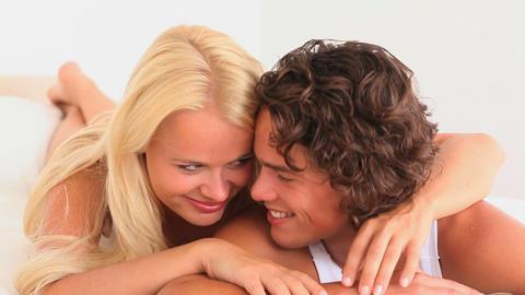 Happy cuddling couple Stock Video Footage