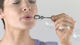 Cute woman blowing bubbles Stock Video Footage