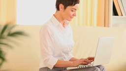 Woman working with a laptop Stock Video Footage