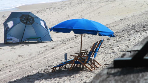 Blue Beach Chair And Umbralla On Sand stock footage
