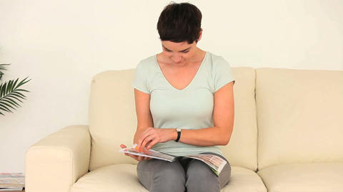 Woman reading a magazine Footage