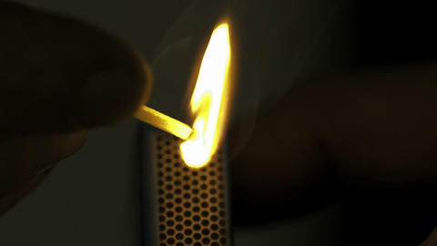 Lighted match in the dark in Slow motion Stock Video Footage