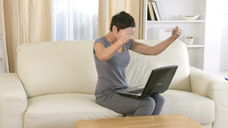Cheerful woman using a laptop Footage
