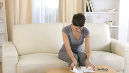 Sad woman reading a letter Footage