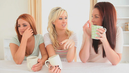 Women sitting at a table with cups of coffee Stock Video Footage