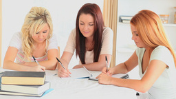 College Students doing their homework together Stock Video Footage