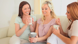 Young women drinking coffee Footage