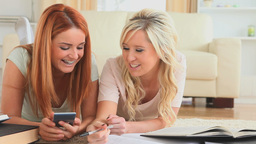 Girlfriends doing their homework together Stock Video Footage