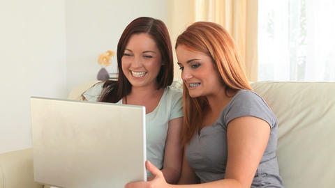 Cheering women with a laptop Stock Video Footage