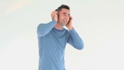 Man dancing with headphones Footage