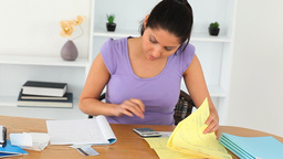 Brunette Woman doing her accounts Stock Video Footage