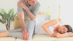 Chiropractor massaging a womans hip Footage