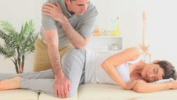 Chiropractor massaging a womans hip Footage