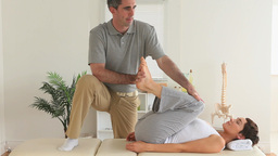 Chiropractor and patient doing exercises Footage