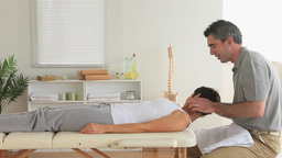 Chiropractor examining a womans neck Footage