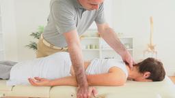 Masseur massaging a cute womans neck Stock Video Footage