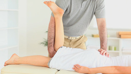 Chiropractor stretching the leg of a woman Stock Video Footage