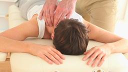 Masseur massaging a gorgeous womans neck Footage