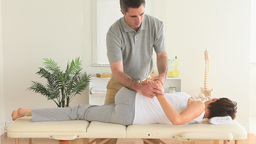 Chiropractor stretching the back of a woman Footage