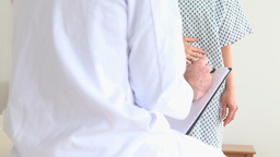 Patient telling doctor what the problem is Stock Video Footage