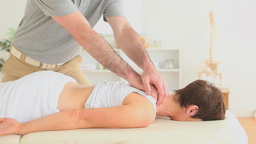 Woman getting a shouldermassage Footage