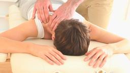 Masseur massaging a womans shoulder Footage