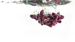 Grapes splashing into water in super slow motion Footage