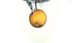 Lemon splashing into water in super slow motion Footage