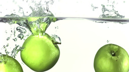 Apples falling into water in super slow motion Animation