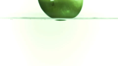 Apple falling into water in super slow motion Stock Video Footage