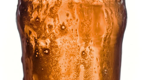 Beer overflowing its glass in super slow motion Stock Video Footage