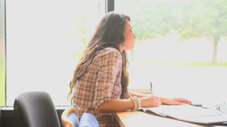 Learning Students sitting at a desk Stock Video Footage