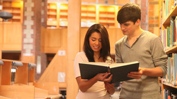 Students reading a book together Footage
