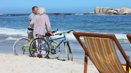 Cyclists discussing at beach Footage