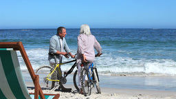 Couple with bikes at beach Footage