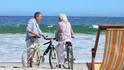 Couple with bikes together at beach Stock Video Footage