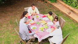 Family having dinner outdoors Footage
