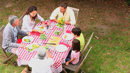 Family dining outdoors together Footage