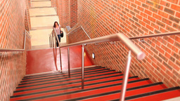 Student climbing stairs Stock Video Footage