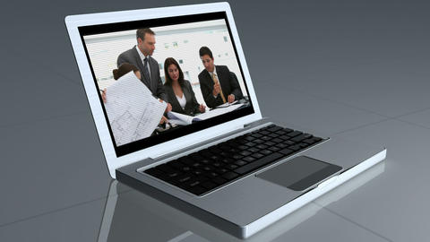 Laptop opens and shows a video of business people Stock Video Footage