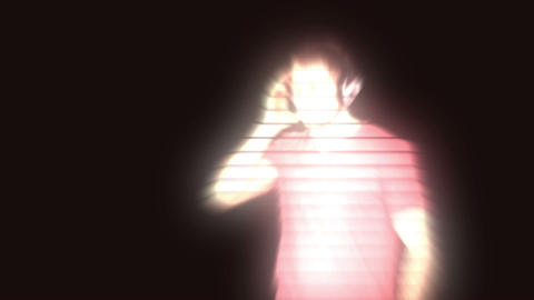 A man with headphones interacting with a 3d interf Stock Video Footage
