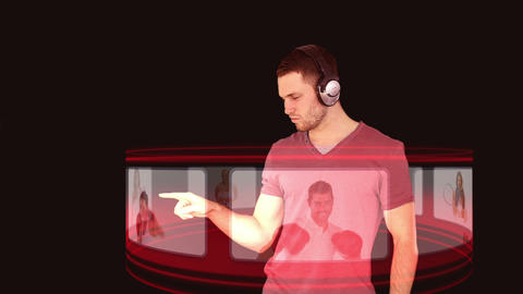 A man with headphones interacting with a 3d interf Animation