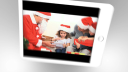 Tablet being used to watch two short christmas rel Animation