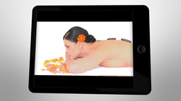 Tablet computer showing spa scenes Animation